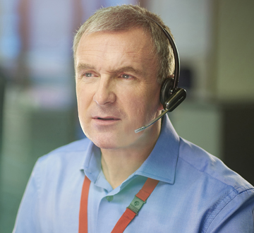 Call center worker wearing a headset